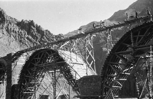 1956: A railway bridge spanning a ravine uner construction to form part fo the Trans-Iranian railway