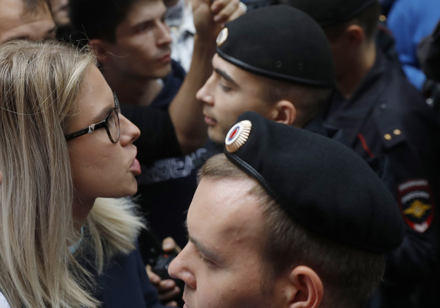 In this file photo taken on July 14, 2019, Russian opposition candidate and lawyer at the Foundation for Fighting Corruption Lyubov Sobol stands in front of police line during a protest in Moscow, Russia. This summer's wave of opposition protests has pushed Sobol to the forefront of the Russian political scene. (Photo by Pavel Golovkin/AP Photo/File)