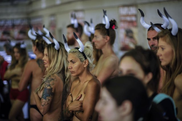 People protest against bull runs beside the bull ring a few days ahead to beginning the famous San Fermin Fiestas,  in Pamplona northern Spain, Saturday, July 4, 2015. (Photo by Alvaro Barrientos/AP Photo)