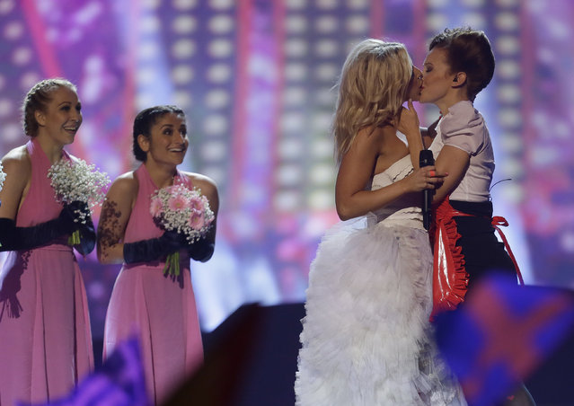 "In this Thursday, May 16, 2013 file photo, Finland's Krista Siegfrids, second right, kisses a dancer as she performs her song ""Marry Me"" during the second semifinal of the Eurovision Song Contest at the Malmo Arena in Malmo, Sweden. That was the first girl-on-girl kiss in the history of the annual competition. Previously, organizers had sought to prevent similar embraces citing the competition's status as a family event. (Photo by Alastair Grant/AP Photo)"