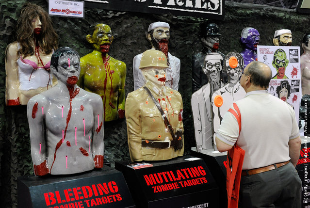 Shooting targets are displayed at the Zombie Industries booth