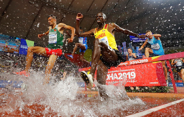 Uganda's Benjamin Kiplagat, left, and Morocco's Mohamed Tindouft, right, compete in the Men's 3000m steeplechase heats at the 2019 IAAF Athletics World Championships in Doha, Qatar on October 1, 2019. (Photo by Kai Pfaffenbach/Reuters)