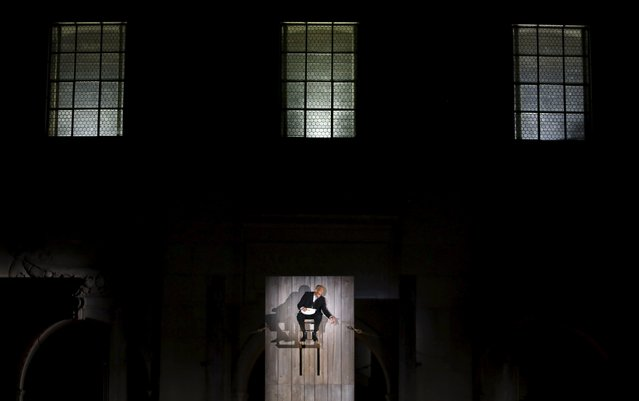 "Actor Hans Peter Hallwachs as Glaube performs on stage during a dress rehearsal of Hugo von Hofmannsthal's drama ""Jedermann"" (Everyman) at Domplatz square in Salzburg, Austria, July 16, 2015. (Photo by Leonhard Foeger/Reuters)"