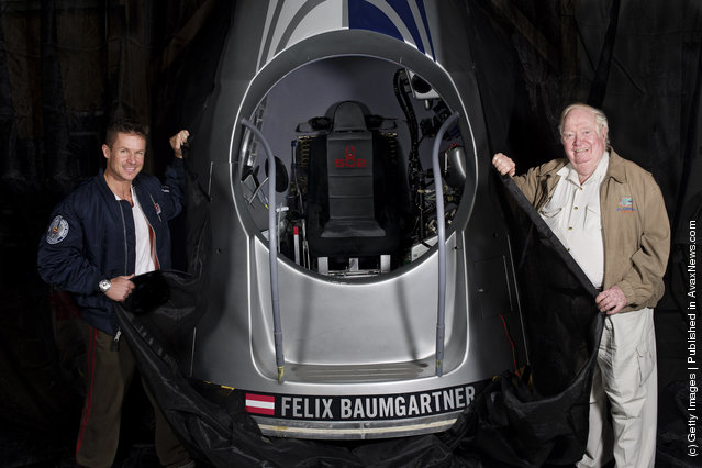 In this photo provided by Red Bull, Pilot Felix Baumgartner (L) of Austria and USAF colonel (ret.) Joe Kittinger of the United States pose with the capsule for Red Bull Stratos