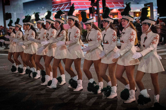 Members of the Porterville High School band perform during the 88th annual Hollywood Christmas Parade in Hollywood, California on December 1, 2019. (Photo by Mark Ralston/AFP Photo)