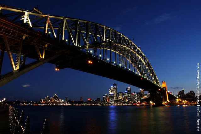 The Sydney Harbour Bridge is seen before the lights are switched off for Earth Hour
