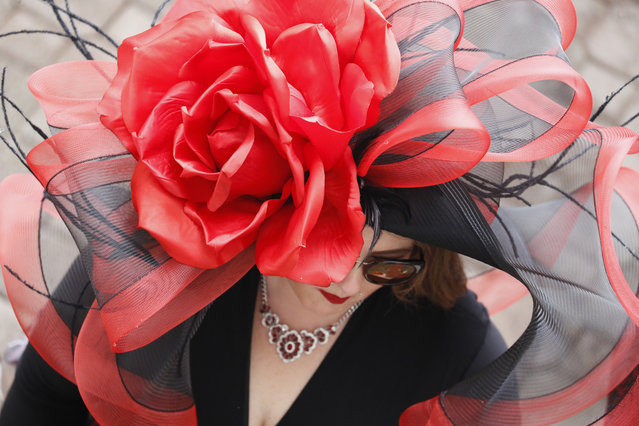 A woman wears a hat before the 145th running of the Kentucky Derby horse race at Churchill Downs Saturday, May 4, 2019, in Louisville, Ky. (Photo by John Minchillo/AP Photo)