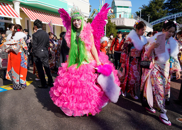 A young Japanese woman dressed in a colorful costume arrives at a ceremony marking the Coming of Age Day at Toshimaen Amusement Park in Tokyo, Japan, 13 January 2020. (Photo by Christopher Jue/EPA/EFE)