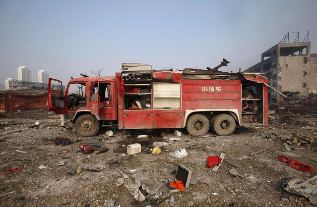A damaged fire truck is pictured at the site of Wednesday night's explosions in Binhai new district of Tianjin, China, August 15, 2015. (Photo by Reuters/China Daily)