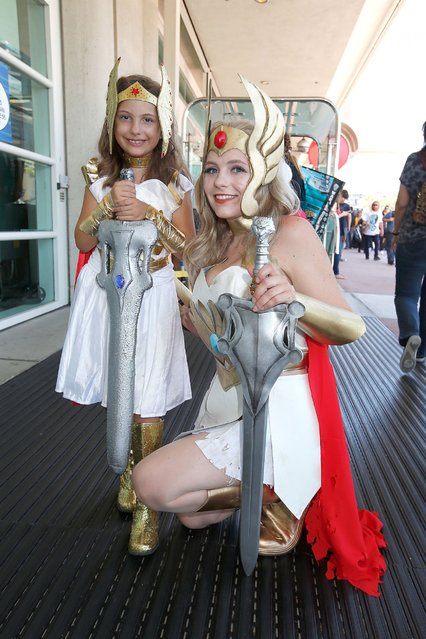 Costumed fans Alexa Kiss and Nicolle Hanbury pose for photos outside the San Diego Convention Center, July 24, 2014, in San Diego. (Photo by Daniel Knighton/Getty Images)