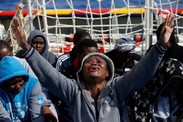 A migrant prays on the Migrant Offshore Aid Station (MOAS) ship Topaz Responder after being rescued around 20 nautical miles off the coast of Libya, June 23, 2016. (Photo by Darrin Zammit Lupi/Reuters)