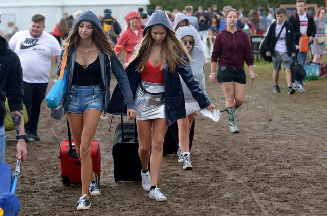 Festival goers arrive at V Festival, Weston Park, Staffordshire, England on August 19, 2017. (Photo by SWNS:South West News Service)