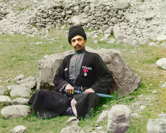 Photos by Sergey Prokudin-Gorsky. Dagestani types. Sunni Muslim man wearing traditional dress and headgear, with a sheathed dagger at his side. Russia, Dagestan region, Avar District, Arakan, 1904