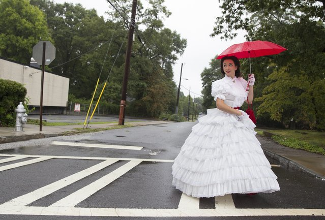 Scarlett o' Hara impersonator Joanna Griffin walks down Flat Shoals Road to commemorate the 150th anniversary of the Battle of Atlanta, in Atlanta, Georgia, July 19, 2014. (Photo by Christopher Aluka Berry/Reuters)