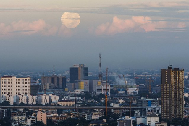 A supermoon is seen over downtown Bangkok August 11, 2014. The astronomical event occurs when the moon is closest to the Earth in its orbit, making it appear much larger and brighter than usual. (Photo by Athit Perawongmetha/Reuters)