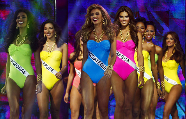 Contestants compete in the swimsuit segment of the Miss Venezuela 2012 pageant in Caracas August 30, 2012. The winner of the competition will participate in the 2013 Miss Universe pageant. (Photo by Carlos Garcia Rawlins/Reuters)