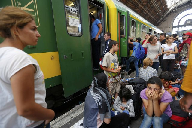 Migrants wait outside a train at the Keleti train station in Budapest, Hungary, September 3, 2015 as Hungarian police withdrew from the gates after two days of blocking their entry. (Photo by Laszlo Balogh/Reuters)