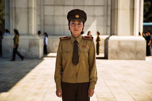 """North Korea: """"Rarely have I seen such a concentration of uniforms; they are everywhere in this society. This woman was a guide at a military museum"""". (Photo by Mihaela Noroc/The Guardian)"""