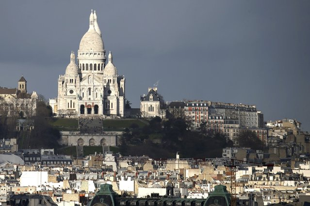 Sunlight strikes the white facade of the Sacre Coeur Basilica on Montmartre in Paris, France, January 14, 2016. (Photo by Charles Platiau/Reuters)