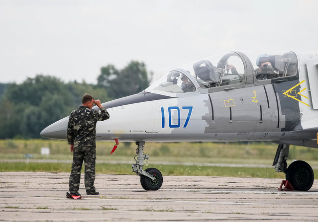 A L-39 Albatross jet trainer aircraft prepares before take off at a military air base in Vasylkiv, Ukraine, August 3, 2016. (Photo by Gleb Garanich/Reuters)