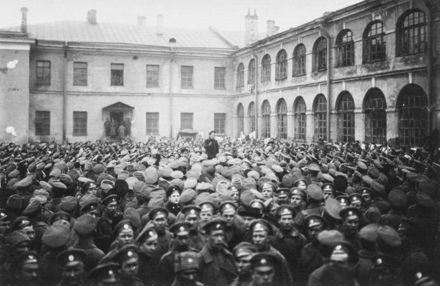 In this photo taken in October 1917, provided by Russian State Archive of Social and Political History, soldiers of the Grenadier Regiments lieby wait for Lenin's arrival on the parade ground near the barracks in St.Petersburg, Russia. The 1917 Bolshevik Revolution was long before the digital revolution allowed anyone to instantly document events. But the clumsy cameras of the time still caught some images that capture the period's drama. (Photo by Russian State Archive of Social and Political History via AP Photo)