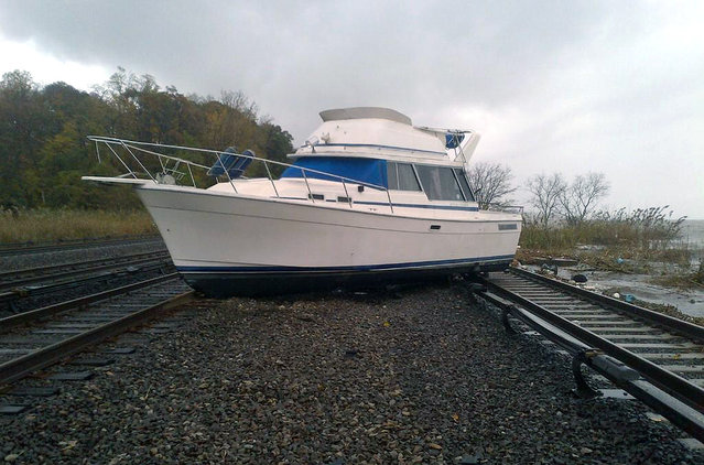 A boat rests on the tracks at Metro-North's Ossining Station on the Hudson Line in the aftermath of Hurricane Sandy, in New York, on October 30, 2012. (Photo by Reuters/MTA)