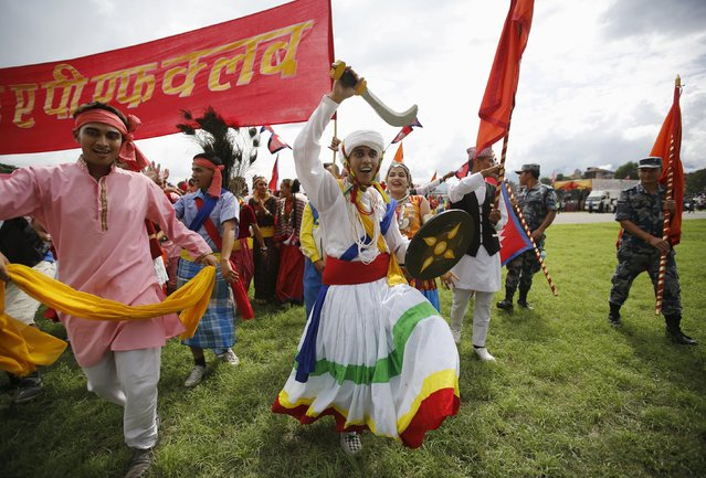 Performers dressed in traditional attire take part in a celebration a day after the first democratic constitution was announced in Kathmandu, Nepal September 21, 2015. (Photo by Navesh Chitrakar/Reuters)