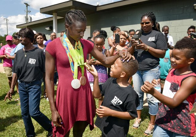 Olympic medalist Tori Bowie greets family and friends at her homecoming and birthday party at Pisgah High School in Brandon, Miss. Saturday, August 27, 2016. (Photo by Elijah Baylis/The Clarion-Ledger via AP Photo)