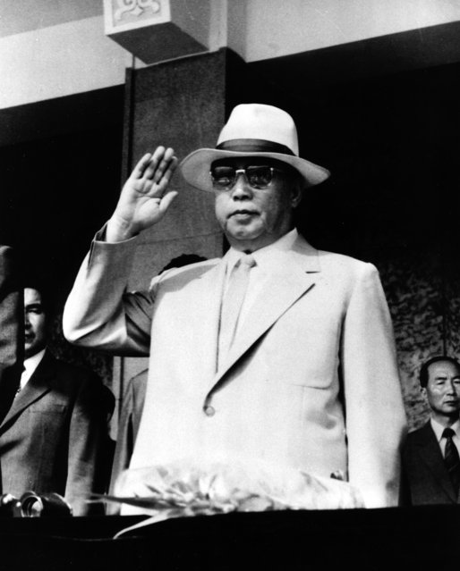 In this August 15, 1985 photo from North Korea's official Korean Central News Agency, distributed by Korea News Service, leader Kim Il Sung waves his hand to the Pyongyang Garrison who marches at the parade celebrating the 40th anniversary of Korea's liberation held at Kim Il Sung Square, North Korea. (Photo by Korean Central News Agency/Korea News Service via AP Images)