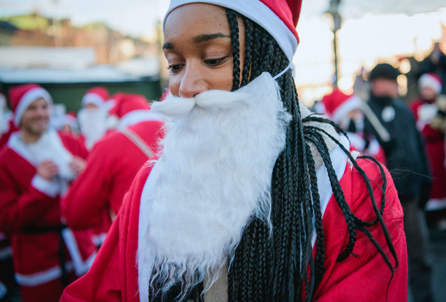 """A charity runner dressed as Father Christmas participates in the """"Santa Run"""" charity fun run in Stockholm on December 10, 2017. (Photo by Jonathan Nackstrand/AFP Photo)"""