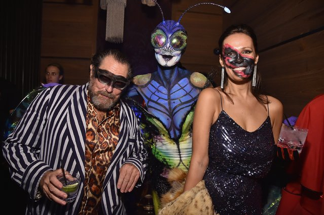Heidi Klum (C) and guests attend Moto X presents Heidi Klum's 15th Annual Halloween Party sponsored by SVEDKA Vodka at TAO Downtown on October 31, 2014 in New York City. (Photo by Mike Coppola/Getty Images for Heidi Klum)