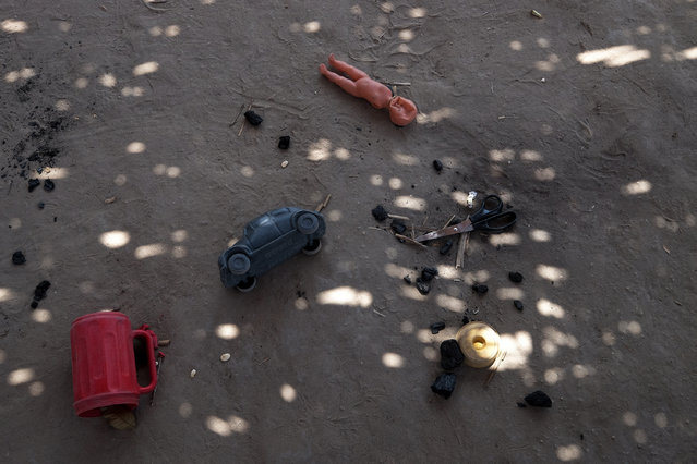 Toys litter the ground in Araribóia Indigenous Reserve, Maranhão, Brazil on August 8, 2015. (Photo by Bonnie Jo Mount/The Washington Post)