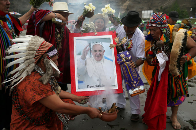 Peruvian shamans perform a ritual prior to the arrival of Pope Francis to Peru, at Pescadores beach in Chorrillos, Lima, Peru, January 17, 2018. (Photo by Guadalupe Pardo/Reuters)