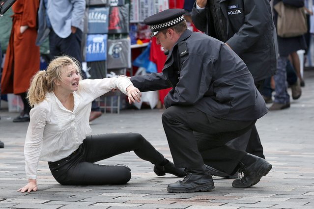"""""""Thrones"""" star, english actress Natalie Dormer is spotted in character filming for new thriller """"In Darkness"""" with Ed Skrein (not pictured) on the streets of London, England, UK on September 12, 2016. """"In Darkness"""" is set to be released next year . (Photo by FameFlynet UK)"""