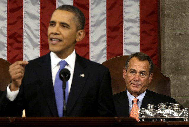 House Speaker Boehner, a Republican from Ohio, looks on as the president speaks on February 12, 2013. (Photo by Charles Dharapak/Bloomberg)