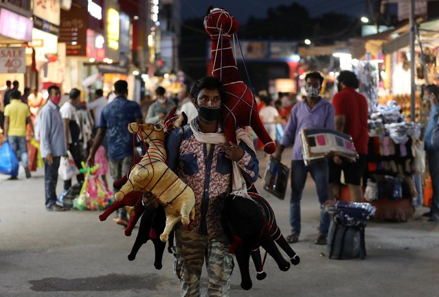 A man selling stuffed toys waits for customers at a market amidst the spread of the coronavirus disease (COVID-19), in New Delhi, India, September 16, 2020. (Photo by Anushree Fadnavis/Reuters)