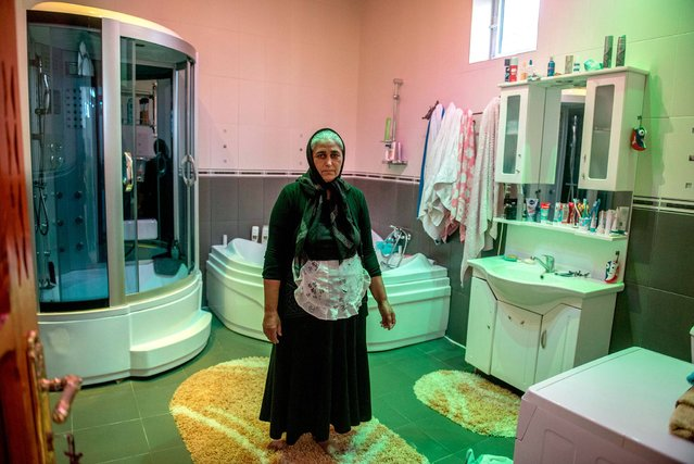 Romania. Ghita, 48, from Buzescu village, says she is the proud owner of one of the biggest bathrooms in the village. It is 20 square meters. 35% of the population of Buzescu village are Romas who are prosperous and proud to show it off. However, there is no running water or sewerage in the village so toilets are on-site. (Photo by Petrut Calinescu/WSUP/Panos)