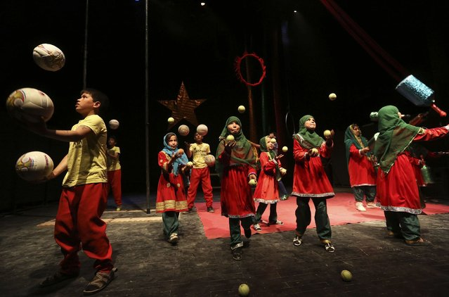Afghan children from the Mobile Mini Circus Children (MMCC) perform during a show at the French Culture center in Kabul, March 13, 2013. (Photo by Omar Sobhani/Reuters)