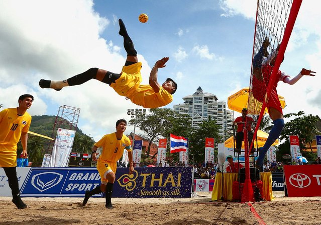 Phakpong Dejaroen of Thailand plays a shot during the Men's Beach Sepaktakraw Regu final between indonesia and Thailand during the 2014 Asian Beach Games at Patong Beach on November 23, 2014 in Phuket, Thailand. (Photo by Cameron Spencer/Getty Images)
