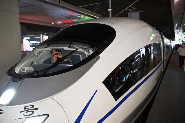 A high-speed train driver prepares to depart from Shanghai Hongqiao railway station in Shanghai December 4, 2014. It will take more than the abrupt cancellation of a high-speed train deal with Mexico to derail China Railway Construction Corp's ambitions to become a global force in transport projects and take on the likes of Siemens, Alstom and Bombardier. (Photo by Aly Song/Reuters)