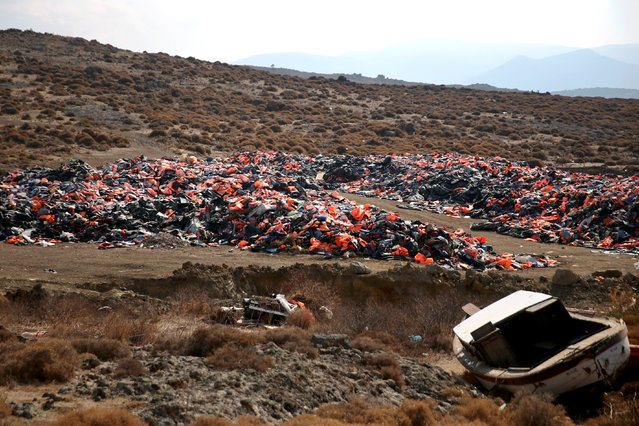 Thousands of lifejackets left by migrants and refugees are piled up at a garbage dump site near the town of Mithymna (also known as Molyvos) on the island of Lesbos, Greece, October 5, 2016. (Photo by Alkis Konstantinidis/Reuters)
