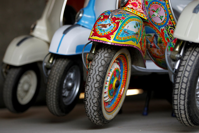 A restored Vespa scooter painted in Pakistani truck art style, is parked alongside traditionally-coloured scooters at a Vespa restoration and repair workshop in Islamabad, Pakistan February 27, 2018. (Photo by Caren Firouz/Reuters)
