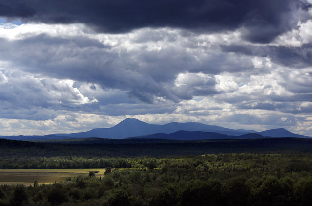 In this Wednesday, August 9, 2017 photo unsettled clouds fill the sky over Mount Katahdin in this view from Patten, Maine. Interior Secretary Ryan Zinke wants to retain the newly created Katahdin Woods and Waters National Monument in northern Maine, but said he might recommend adjustments to the White House on Thursday, Aug. 24, 2017. (Photo by Robert F. Bukaty/AP Photo)