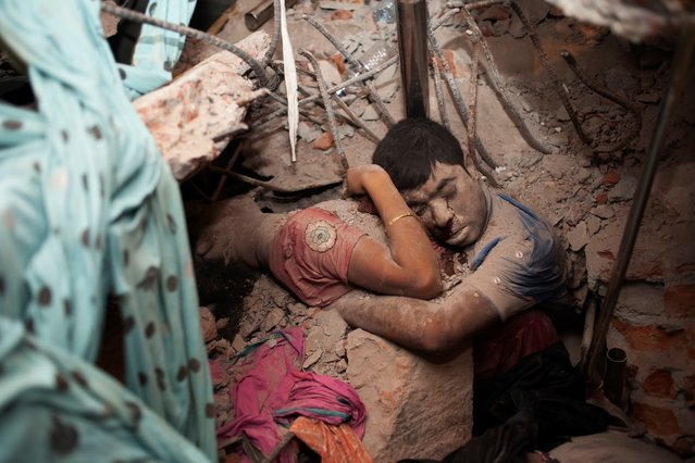 Two victims amid the rubble of a garment factory building collapse in Savar, near Dhaka, Bangladesh, April 25, 2013. (Photo by Taslima Akhter)