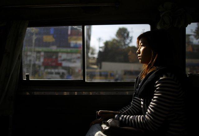 A woman rides a women-only bus in Kathmandu January 6, 2015. (Photo by Navesh Chitrakar/Reuters)