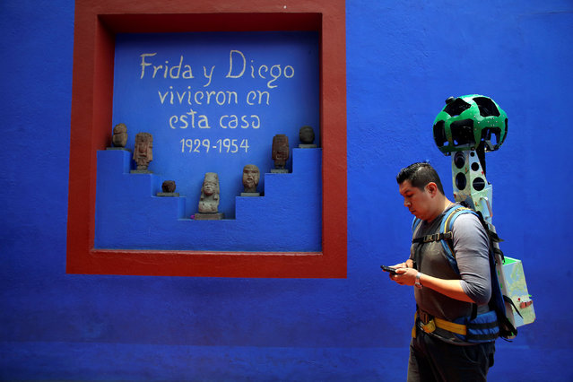 """A Google employee maps the exterior of the childhood home of Mexican artist Frida Kahlo, now Frida Kahlo Museum, also known as """"Casa Azul"""", in Mexico City, Mexico May 21, 2018. (Photo by Gustavo Graf/Reuters)"""