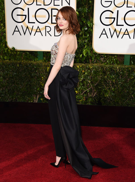 Emma Stone arrives at the 72nd annual Golden Globe Awards at the Beverly Hilton Hotel on Sunday, January 11, 2015, in Beverly Hills, Calif. (Photo by Jordan Strauss/Invision/AP Photo)