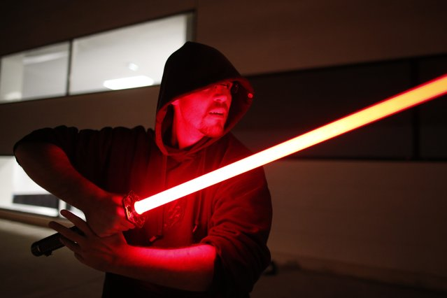 An instructor demonstrates his skill during a light saber tournament organized by the Sport Saber League in Paris, France, October 29, 2015. (Photo by Charles Platiau/Reuters)