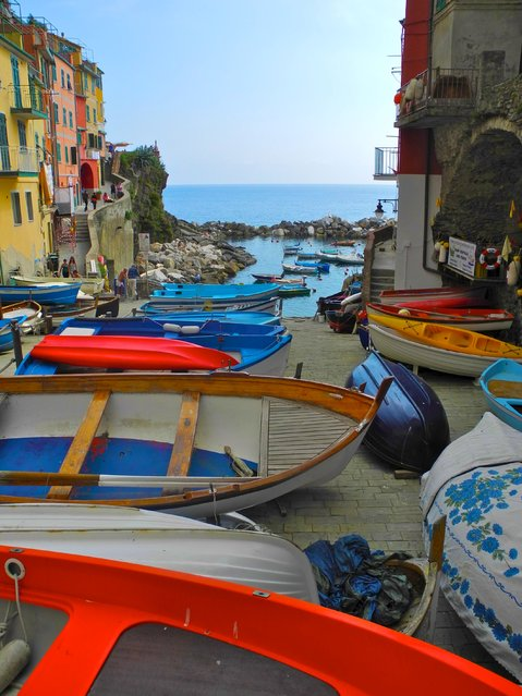 """Harbor"". A jumble of colorful boats litter the ramp at Riomaggiore's tiny harbor. Location: Riomaggiore, Italy. (Photo and caption by Doug Croft/National Geographic Traveler Photo Contest)"