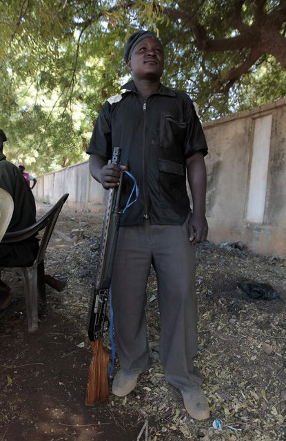 A traditional hunter, one of a militia group helping the army to fight the Boko Haram insurgence, poses for a photograph in Yola, Adamawa State January 14, 2015. (Photo by Afolabi Sotunde/Reuters)